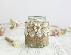 Rustic style pen holder perfect for the guest book table.  The jar has been decorated using hessian, lace and pearl embellishments.  I can change the colours/materials to suit your wedding theme, please just add a note on your order if you require any changes.  Lead time 2 weeks  Jar shape may change depending on stock however decoration will remain the same.  Have a browse at my other wedding items Www.flutterbybazaar.etsy.com