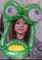 Monster mask made of balloons, as you can see, this child is quite excited!
