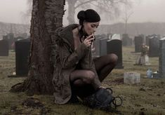 Women's Fashion and Style, Dark, occult.  Felice Fawn Gallery. Girl in cemetery, tombstones.