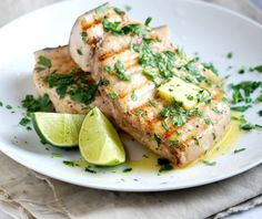 Grilled Swordfish with Lime  olive oil, ground coriander, salt and pepper, handful of cilantro leaves, coarsely chopped, lime, butter