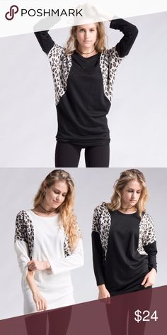 Leopard Insert Black Tunic Long sleeves sweatshirt like tunic. Black with leopard inserts. Round neck.   Color: Black & leopard  Fabric: polyester/cotton  🔹bundle 2 or more for a special discount  🔸offers on single items not accepted Tops