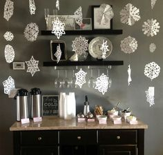 Hot cocoa bar for a winter wonderland gathering. Intricate handmade paper snowflakes stacked and hung make a charming decor piece.