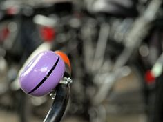 Foto made by Tamara Burgering, in Haarlem, The Netherlands. Bike bell with bikes in background.
