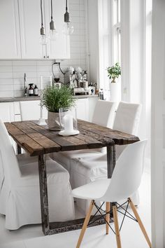 Wooden Table And White Kitchen Chairs