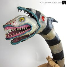 A carved foam, themed display for an original Beetlejuice sandworm puppet movie prop used in the Tim Burton and Michael Keaton classic. Beetlejuice Sandworm, Beetlejuice Movie, Beetlejuice Halloween, Diy Halloween Decorations, Halloween Crafts, Halloween Trophies, Elmo, Halloween Juice, Craft Ideas