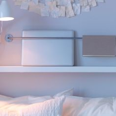 From IKEA.  Great for over the top bunk!   BYGEL rail and LACK shelf.