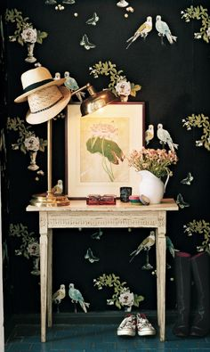 Dramatic wallpaper in a shoe-box sized entryway makes a bold statement | domino.com