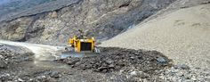 A machine clearing slides along Mughal Road at Lal Gulam. Excelsior/Younis Khaliq
