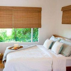 Blinds.com Brand Budget Woven Wood Shades in Malay Oak. Choose between a variety of rich textures and colors that will add natural warmth for an affordable price.