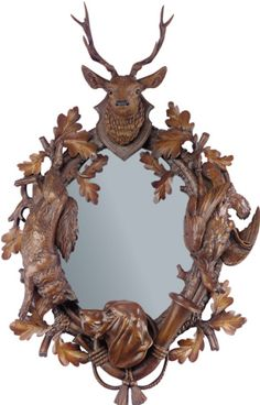 """This high quality reproduction of a mid 19th century black forest mirror, features a Hound Dog, Elk, Fox and Grouse.  Made of resin.29"""" high x 19"""" wideMADE IN THE USA.  PLEASE ALLOW 3 WEEKS DELIVERY."""
