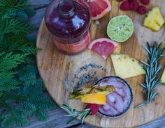 This festive cocktail, dubbed the Mele Kalikimai Tai, is a blend of rum, fresh fruit juices, and rosemary. It's almost as good as a Hawaiian getaway.