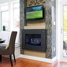 Slender glass tiles arranged vertically add visual height and drama around this sleek fireplace. A dark color palette warms up the contemporary space, while the trendy narrow tiles maintain a modern vibe.
