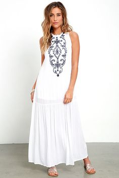 We're just waiting by the window for the breeze to bring the Cloud Kisses White and Blue Embroidered Maxi Dress our way! Navy blue beaded embroidery decorates the sleeveless bodice of this woven rayon dress, with a high ruffled neckline and drop waist skirt. Back keyhole has tying straps ending in silver jingle bells.