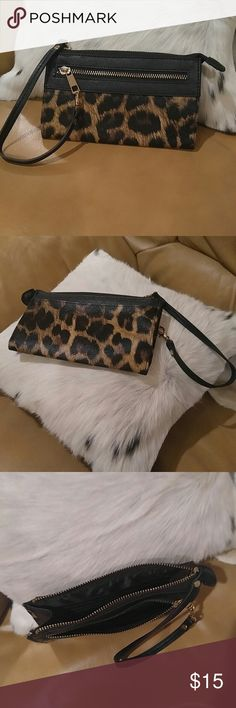 Leopard print wristlet. Leopard print wristlet. Brand new, never evens used. Bags Clutches & Wristlets