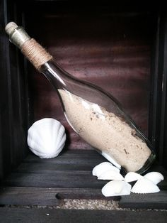 Memory in a bottle! This is a fun and creative way for your family to treasure a special memory from the beach or a camping trip.  Collect rocks, shells, and sand from the trip and store in an used wine bottle. Seal and display to cherish the memory. Visit my Facebook page for more creative ideas!