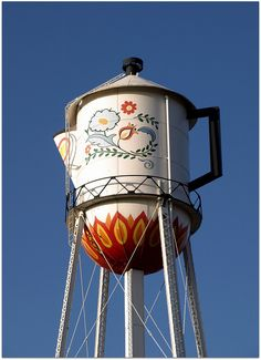 I'm sort of in love with water towers lately. This one is adorable!   World's Largest Coffee Pot by Jenny with a camera, via Flickr