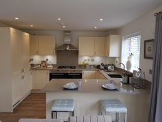 This is the exact kitchen we will be getting in our new build, except ours will be U- shaped with an island and in a different house/room. Cream shaker units and grey quartz worktops 💛💙 Cream Kitchen Cupboards, Grey Kitchens, New Builds, Farm House, Modern Farmhouse, Kitchen Ideas, House Ideas, New Homes, Quartz