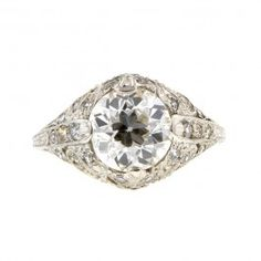 Edwardian Style Engagement Ring, Old Euro 2.01ct::centering a Old European cut diamond weighing app. 2.01ct. (G-H color, SI1 clarity), additionally set with twenty four diamonds (23 Single cuts, 1 round Brilliant cut) all weighing app. 0.36ctw., fashioned in platinum. Estate - Edwardian style. Size 5.25. EGL-US65160101D