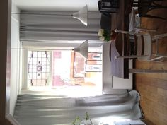 The sun is shining in our house through the glas-in-lood glass.