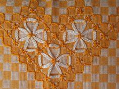 Última flor do Lácio: Bordado em tecido xadrez
