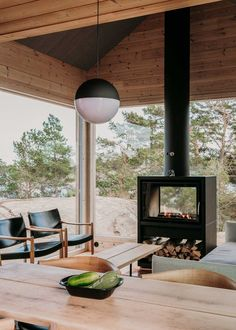 Finnish designers Aleksi Hautamaki and Milla Selkimaki purchased a island two years ago, on the edge of the Archipelago National Park in Finland, and have since built this self-sufficient summer house that includes a sauna, a guesthouse and a Two Sided Fireplace, Home, Island Design, Scandinavian Cabin, Wooden Cabins, Wood Stove, Modern Cabin, Wood Burning Stove, Summer Cabins