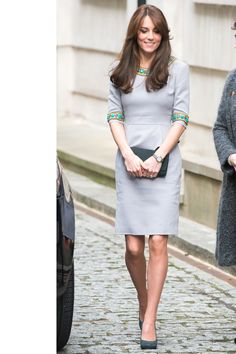 "The Duchess steps out for the ""My Head Is Too Full"" in a pastel dress by Matthew Williamson, adorned with turquoise trim and teal accessories.    - HarpersBAZAAR.com"