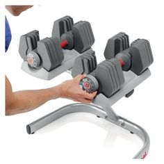 Universal Power-Pak 445 Adjustable Dumbbells ~~~ # Each dumbbell adjusts from 4 to 45 pounds # Replaces 9 sets or 18 individual dumbbells # Includes an ergonomically designed dumbbell stand # Workout guide # Exercises Available: 30+ # Weight Settings: 9 #Dumbbells #Workout #HomeGym