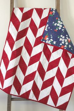 red and white herringbone quilt.