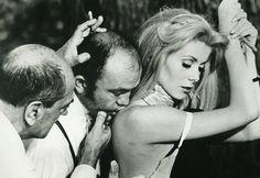 "Director Luis Bunuel poses actress Catherine Deneuve for a scene during the production of the 1967 film ""Belle de Jour""."