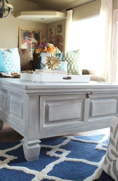 I transformed this brown coffee table white using a car wash sponge and Heirloom Tradition's Thunderous and Buttermilk chalk type paints and White Lime Furniture Wax - Refunk My Junk