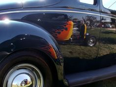 Deuce coupe reflected in 40 Ford.