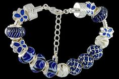 silver plated items: bracelet with lobster, enamel beads, balls, locks. Five glass beads with 925 silver core.