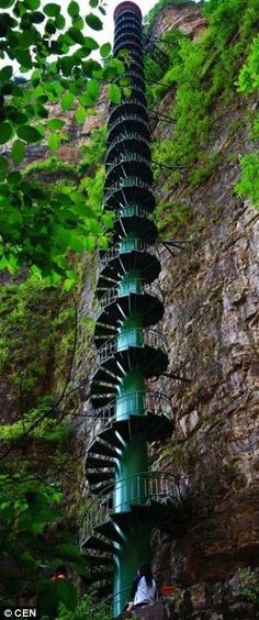 The 300ft spiral staircase has been installed on the wall of the Taihang Mountains in Linzhou, China, to offer the thrill of mountaineering without the danger. 'Here the wind blows and batters them, the birds fly past them, the stairs creak. It is a lot more authentic than an elevator,' explained one official. via dailymail.co.uk