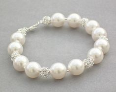 Nice and simple, this Bridal bracelet uses White Swarovski Pearls (also available in Ivory) There are beautiful size crystal encr Wedding Earrings, Wedding Jewelry, Wedding Bracelets, Bridal Bracelet, Pearl Bracelet, Bridesmaid Jewelry, Bridesmaid Gifts, Swarovski Pearls