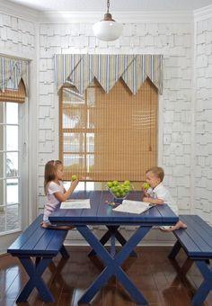 beach style kitchen by Peridot Decorators, Inc. Love the cobolt blue table