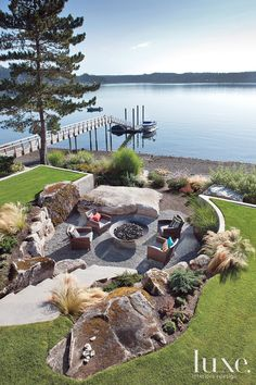 A hollow was dug for an alfresco living room and protected firepit outside this Washington home.