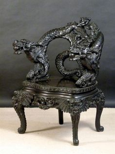Early 20th century heavily carved and black stained Japanese dragon armchair.