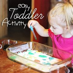Easy Toddler Activity for Rainy Days (This activity was so fun and so simple! Next time I want to try laying paper underneath the baking soda to see if we can make a more permanent version.)