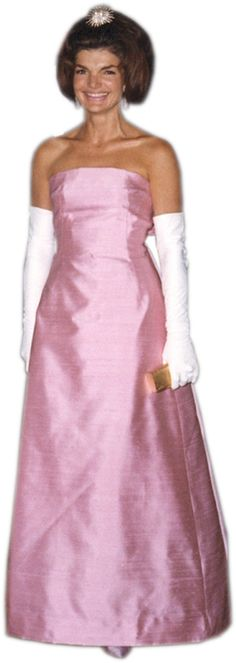 First Lady Jackie Kennedy as she was dressed for dinner with the French cultural minister, April 1962. Mrs. Kennedy wears a gown designed by Oleg Cassini