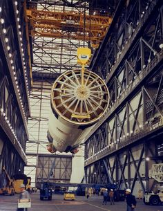 A crane lifts the S-IC first stage in preparation for stacking on a mobile launcher within the VAB's High Bay 1 February 21, 1969