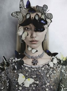 Soo Joo  by Kevin Mackintosh for Vogue Italia September 2012    Imagery: Butterflies = Monarch Mind control, One Eye symbolism