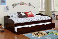 """Sunset collection traditional style low profile style espresso finish wood day bed with trundle.  Day bed measures 79"""" W x 41 3/8"""" D x 23 1/4"""" H.  Slat Kit included.  Some assembly required."""