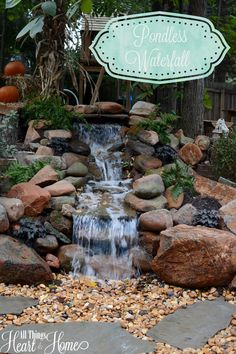 The Husband put in a pondless waterfall as part of our big backyard makeover! Today, I'm giving you a peek at the waterfall and the backyard project!
