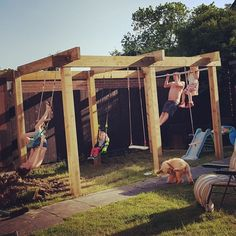 Our garden pergola / climbing frame with swings, monkey bars, trapeze bars and a pull up bar. Just need to grow some stuff up it now! Diy Pergola, Pergola Swing, Wooden Pergola, Pergola Plans, Pergola With Swings, Outdoor Pergola, Pergola Shade, White Pergola, Pergola Roof
