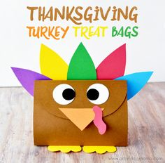 Thanksgiving Turkey Treat Bags with Free Printable Template! Make cute and colorful DIY party favors for your guests to take home with them after Thanksgiving dinner.