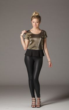 Add just the right amount of sparkle to your outfit. Subtly corrugate metallic adds a touch of depth and shine. Cap sleeves and chiffon peplum pull together a cute yet sophisticated look. V-back with zipper. $23.50