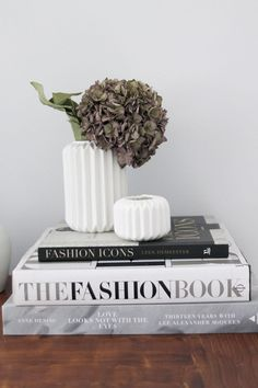 Books and plants or flowers, just looks good.