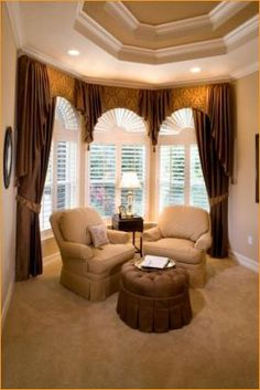 window treatment - pairing of shutters and drapes in sitting area arched valances Arched Window Treatments, Custom Window Treatments, Window Coverings, Bedroom With Sitting Area, Drapery Designs, Beautiful Curtains, Bay Windows, Furniture Placement, Window Styles