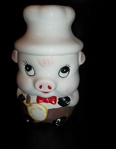 Little pig cookie jar dressed as a chef. He is in really good condition for his age. There is some missing paint and a few small chips on the inside of the lid. Stamped Taiwan on the bottom. There is