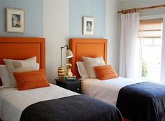 I like the pairing of orange with the pale and dark blues. Also the texture of the orange pillows.